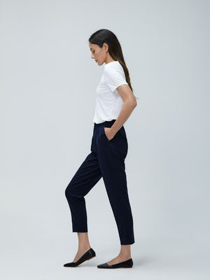 Women's White Luxe Touch Tee and Women's Navy Swift Drape Pant on Model walking left
