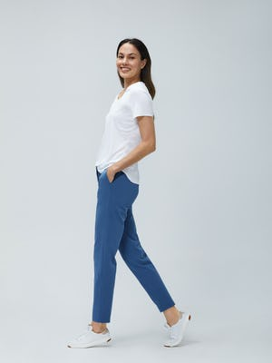 Women's White Luxe Touch Tee and Women's Storm Blue Momentum Chino on Model Walking Left