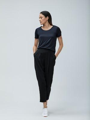 Women's Black Luxe Touch Tee and Women's Black Swift Drape Pant on model walking forward