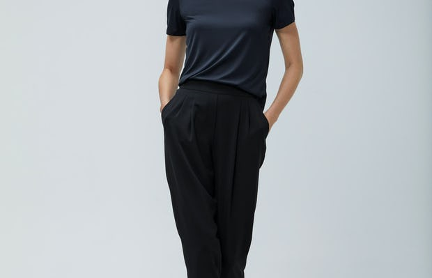 Women's Black Luxe Touch Tee and Women's Black Swift Drape Pant on model walking forward