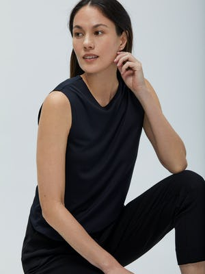 Women's Black Luxe Touch Tank on Model Sitting with arm on leg