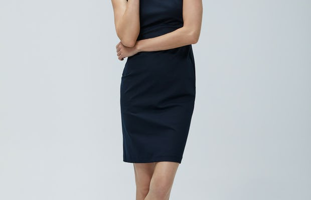Women's Navy Kinetic Sheath Dress on Model facing forward with arms crossed