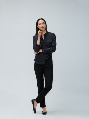 Women's Black Juno Patch Pocket and Women's Black Fusion Straight Leg Pant on Model facing forward with crossed legs