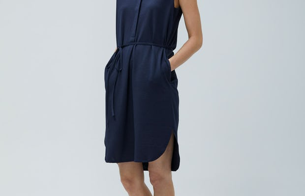 Women's Navy Hybrid Seersucker Dress Navy on Model Walking left and looking backwards