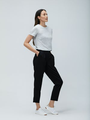 Women's Light Grey Composite Merino Tee and Women's Black Swift Drape Pant on Model facing right