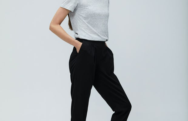 Women's Light Grey Composite Merino Tee and Women's Black Swift Drape Pant on Model facing right