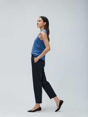 Women's Storm Blue Recycled Composite Merino Tank and Women's Navy Tweed Fusion Pull-On Ankle Pant on model walking left