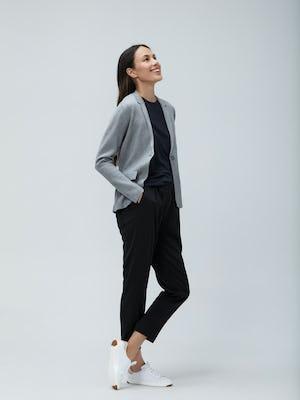 Women's Light Grey Atlas Knit Blazer layered over Women's Luxe Touch Tank Black and Women's Black Swift Drape Pant on Model facing right
