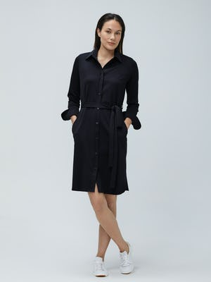 Women's Black Apollo Shirt Dress on Model facing forward with legs crossed