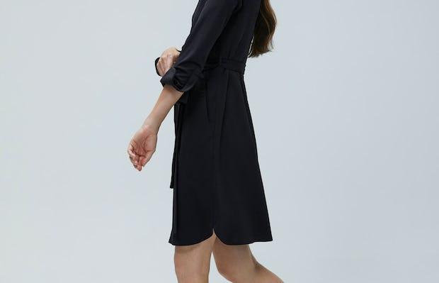 Women's Black Apollo Shirt Dress on Model walking left