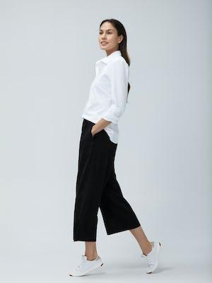 Women's White Aero Zero Dress Shirt and Women's Black Swift Wide Leg Pant on Model walking left