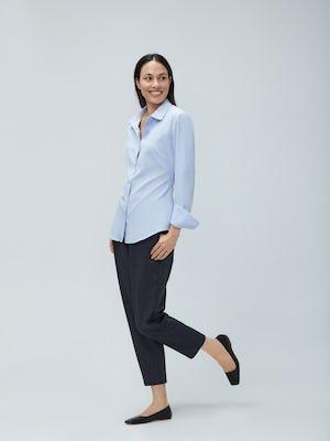 Women's Light Blue Aero Zero Dress Shirt and Women's Navy Tweed Fusion Pull-On Ankle Pant on Model Walking Left