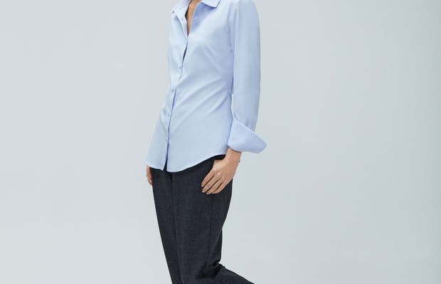 Women's Light Blue Aero Zero Dress Shirt and Women's Navy Tweed Fusion Pull-On Ankle Pant on Model Walking Left
