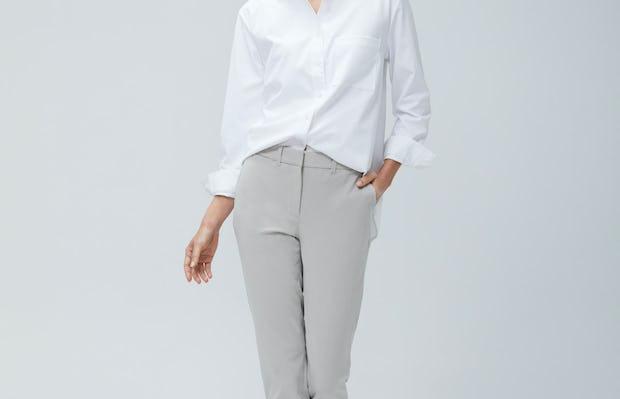 Women's White Aero Zero Boyfriend Shirt and Women's Light Khaki Momentum Chino on model walking forward