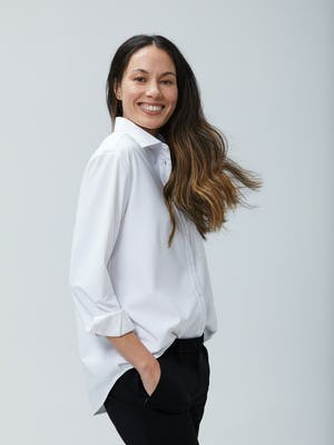 Women's White Aero Zero Boyfriend Shirt on Model facing right with hand in pant pocket