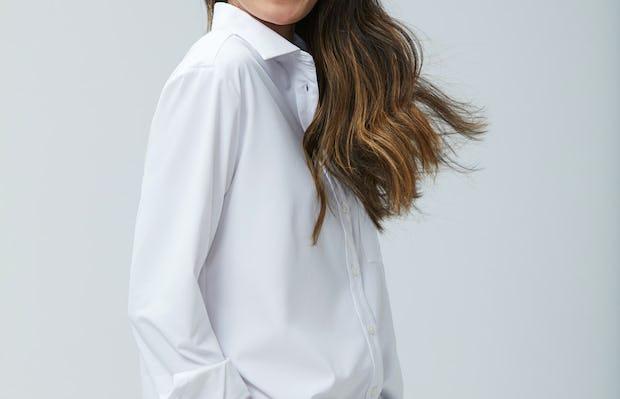 Women's White Aero Zero Boyfriend Shirt on Model facing right with hand in pant pocket