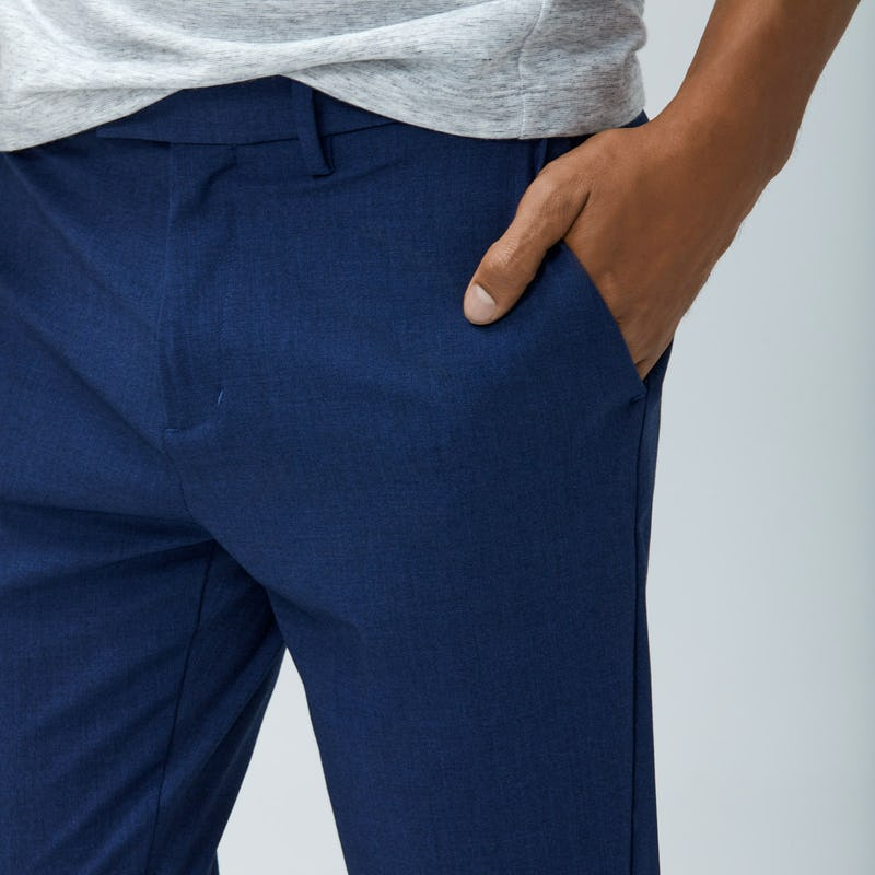 Close up of Men's Indigo Heather Velocity Pant on Model with hand in pocket