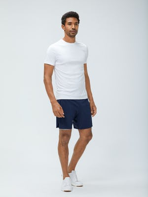 Men's White Responsive Crew Neck Tee and Navy Newton Active Shorts on Model Facing Right