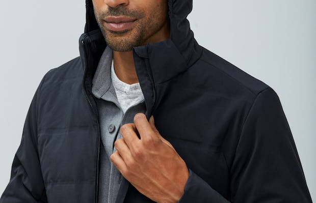 Close up of Men's Black Mercury Intelligent Heated Jacket on Model with hood up