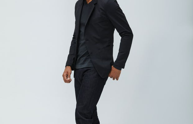 Men's Black Kinetic Blazer and Black Chroma Denim on model walking left