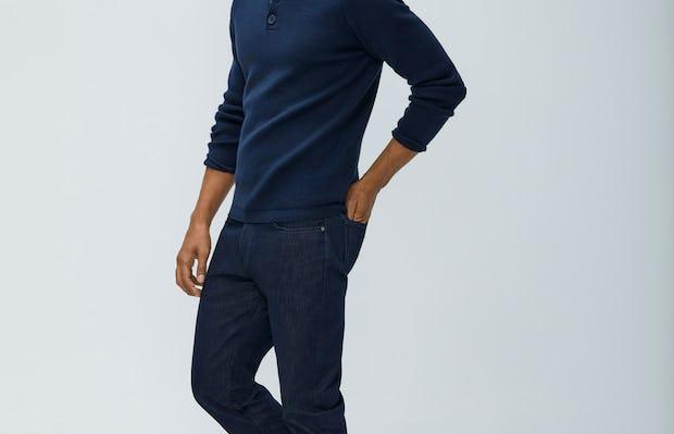 Men's Navy Atlas Merino Button Collar and Men's Indigo Chroma Denim on model facing left with legs crossed