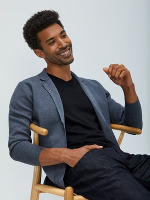 Men's Grey Atlas Knit Blazer over Men's Black Atlas V-Neck Tee on model sitting in chair