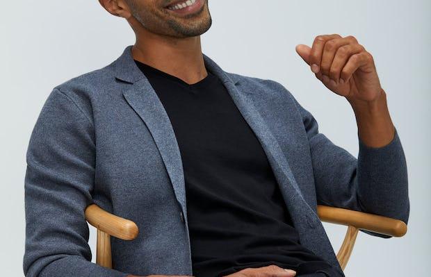 Men's Grey Atlas Knit Blazer over Men's Black Atlas V-Neck Tee on model sitting in chair