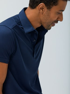 Close up of Men's Navy Apollo Polo on Model facing right