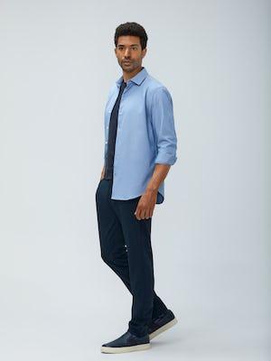 Men's Blue Oxford Aero Zero Dress Shirt and Men's Dark Navy Velocity Pant on model walking left