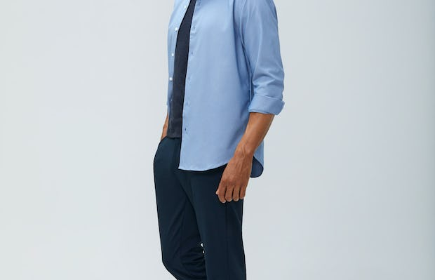 Men's Blue Oxford Aero Zero Dress Shirt and Men's Dark Navy Velocity Pant on model walking left