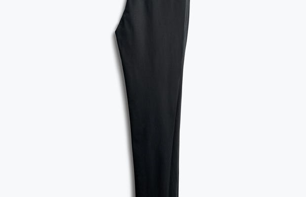 Women's Black Skinny Kinetic Pants folded in half back