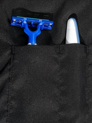 doppler essentials kit zoomed shot of organizational slots holding toothbrush and razor