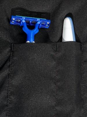 doppler essentials kit zoomed shot of organizational slots holding toothbrush and razor