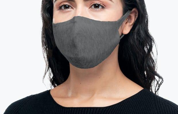 model wearing marble 3d print knit mask 2.0 facing forward