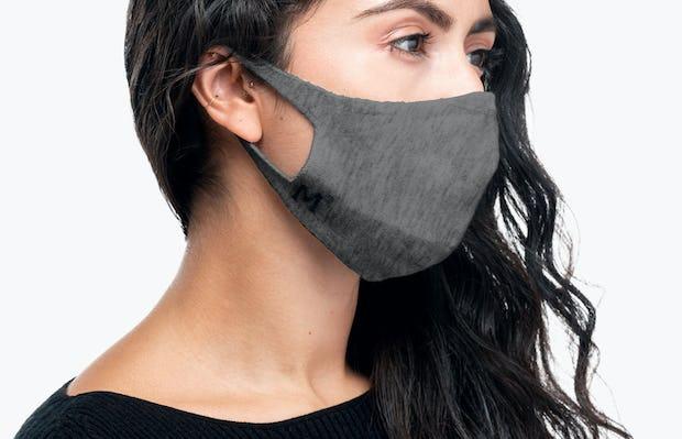 side shot of model wearing marble 3d print knit mask 2.0