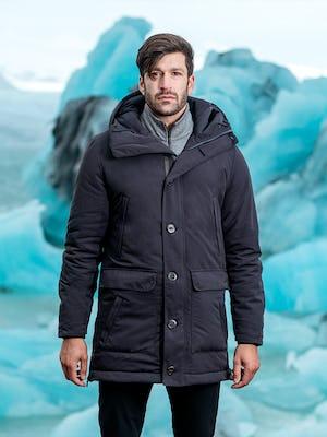 model wearing great auk down-less parka zipped facing forward