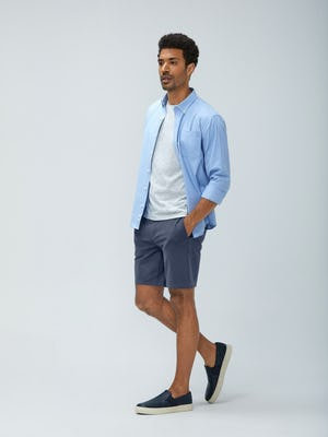 men's chambray mini grid aero button down and men's light grey composite merino tee and men's slate blue kinetic shorts model with hands in pockets