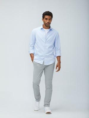 men's light blue aero zero dress shirt and men's stone momentum chino model walking forward with hand in pocket