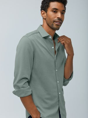men's olive heather brushed apollo dress shirt model with sleeves rolled hand on collar