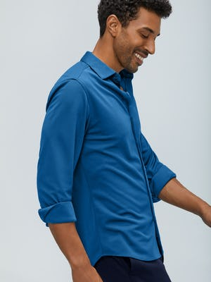 men's royal blue recycled apollo dress shirt model walking right with sleeves rolled