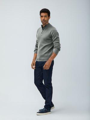 men's light grey atlas merino button collar and men's indigo chroma denim sleeves pulled up model facing slightly left