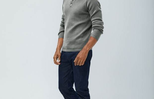 men's light grey atlas merino button collar and men's indigo chroma denim sleeves pulled up model facing slightly left
