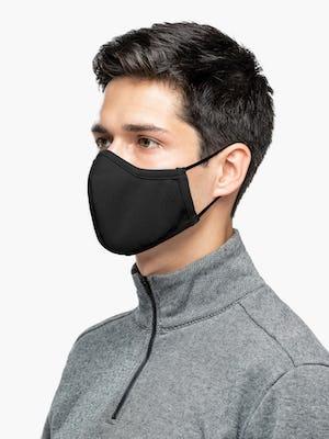Man wearing Black Apollo Mask