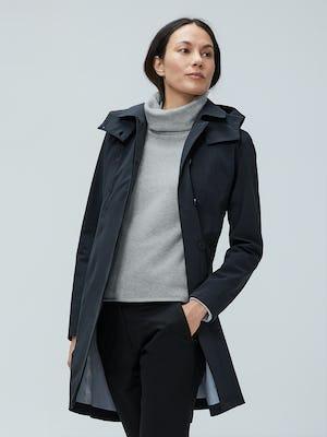 model wearing women's black doppler mac raincoat and women's marble hybrid fleece funnel neck