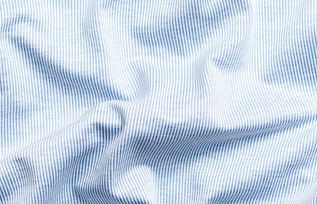 men's blue heather stripe hybrid button down zoomed shot of wavy fabric