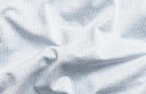 men's grey heather stripe hybrid button down zoomed shot of wavy fabric