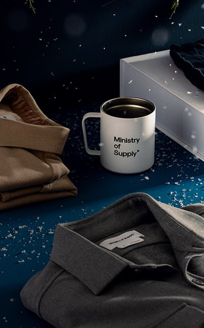 A gift box with a coffee mug and two Fusion Overshirts