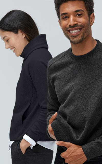 Woman wearing Hybrid Funnel Neck Sweater and man wearing Hybrid Crew Neck Sweater