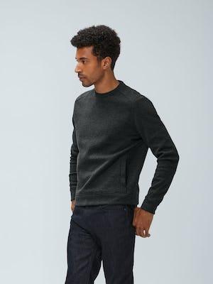 Men's Charcoal Heather Hybrid Fleece Crewneck Sweatshirt and Men's Black Chroma Denim on model with hand in pocket