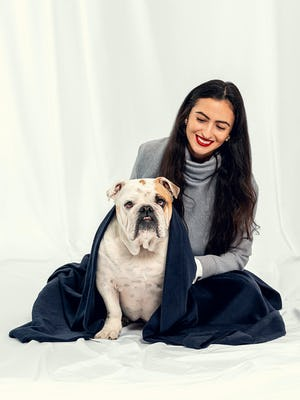 Woman and her dog with Navy Hybrid Everywhere Blanket draped over them